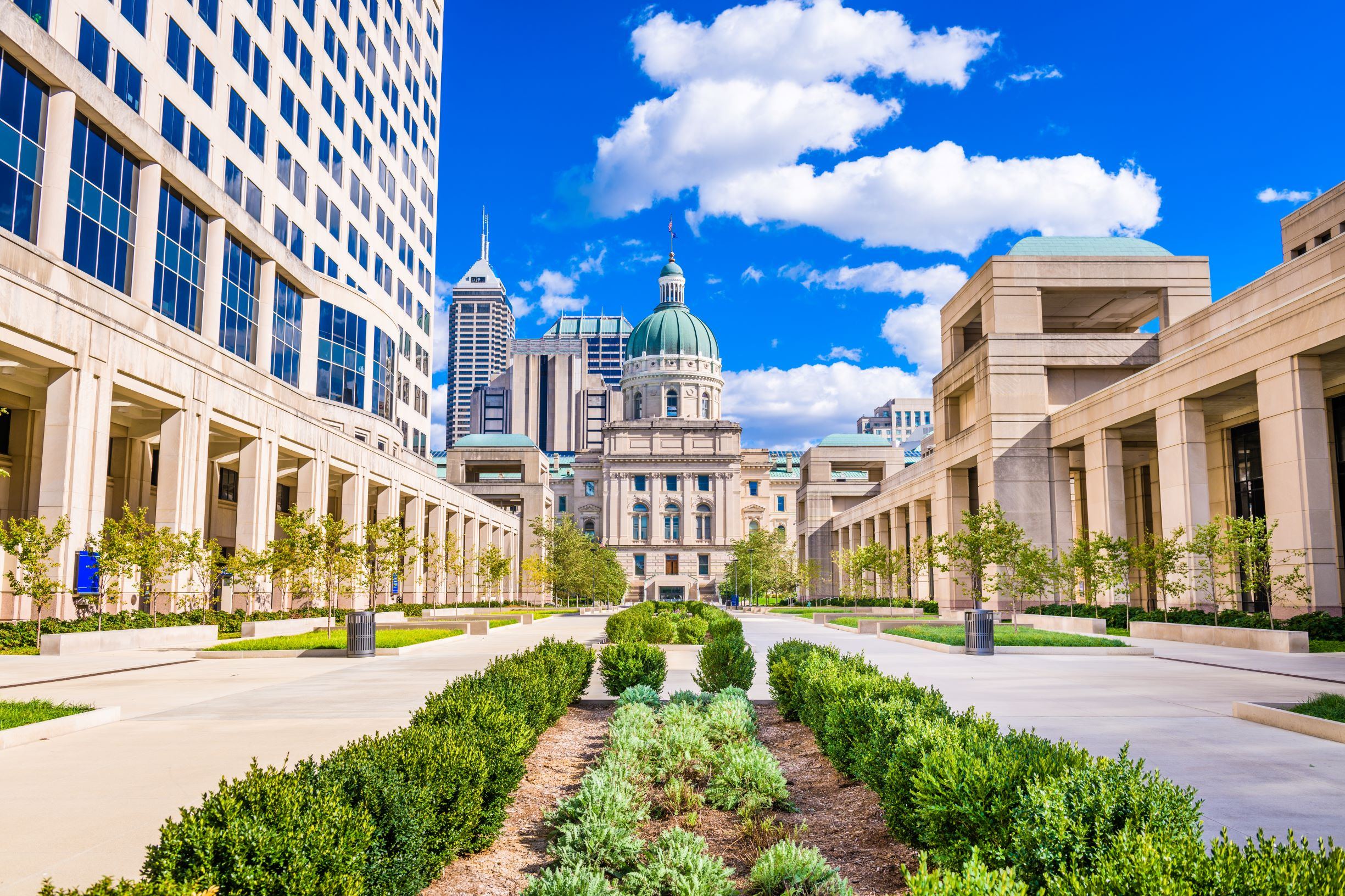 The Indiana State Capitol building is set amid beautiful landscaping. Indianapolis bail bonds can be tricky for numerous reasons, including differences in bail bonds processes as well as state laws.